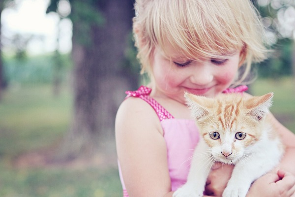 a young girl with a cat