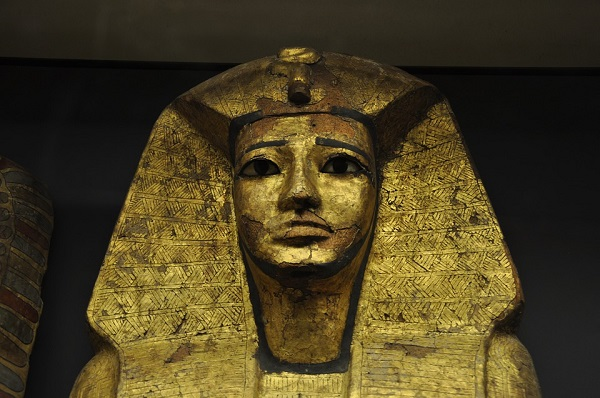 Golden pharaoh mask in a museum
