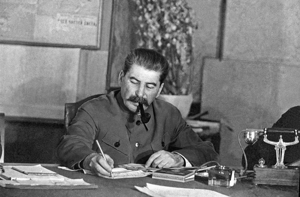 Joseph Stalin sitting at a desk in March 1935