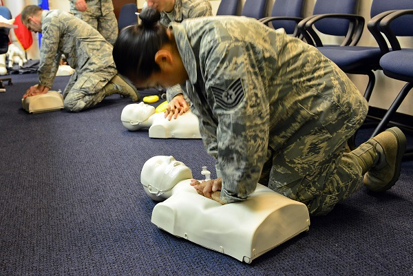 Woman practicing CPR on a mannequin