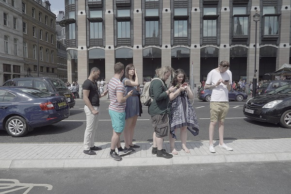 6 people playing Pokemon Go in London