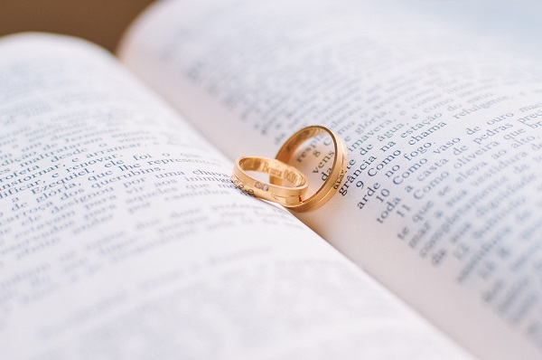 Two rings on the pages of a book