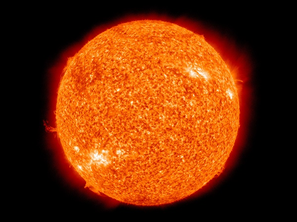 a red sun on a black background