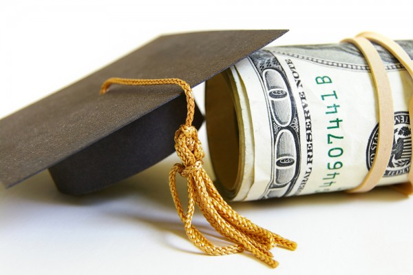 closeup of graduation cap and cash roll