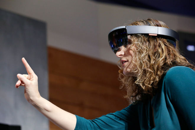 alt= Microsoft's Lorraine Bardeen demonstrates a hologram device at an event demonstrating new features of its flagship operating system Windows at the company's headquarters Wednesday, Jan. 21, 2015, in Redmond, Wash. Executives demonstrated how they said the new Windows is designed to provide a more consistent experience and a common platform for software apps on different devices, from personal computers to tablets, smartphones and even the company's Xbox gaming console. (AP Photo/Elaine Thompson)