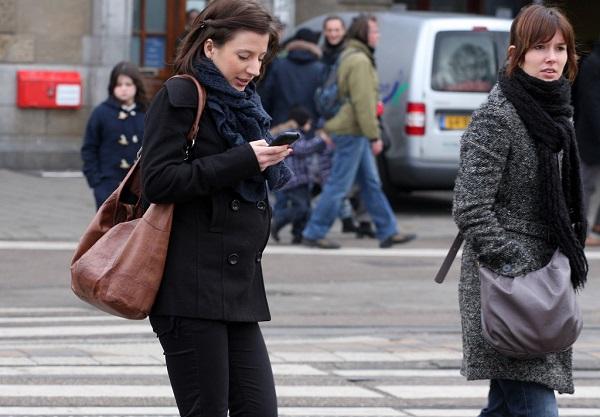 women crossing the street