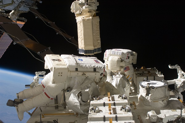 Two astronauts on a space walk.