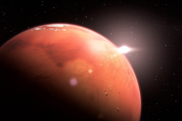 surface of red planet with star shining in the background